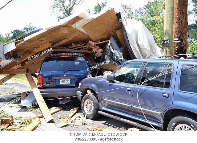 Several cars are destroyed after the roof of a nearby apartment building was torn off and landed on the cars nearbyduring a severe thunderstorm in Bladensburg