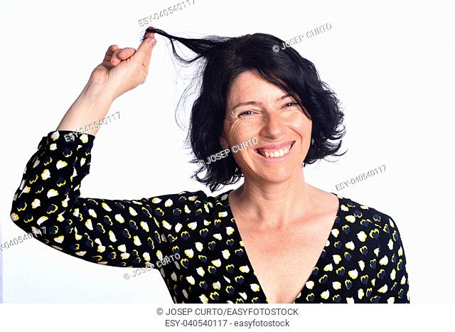 woman touching her hair on white