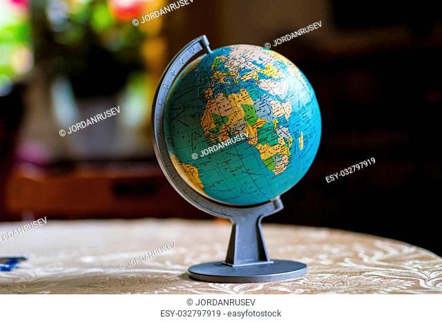 Old globe on table of school