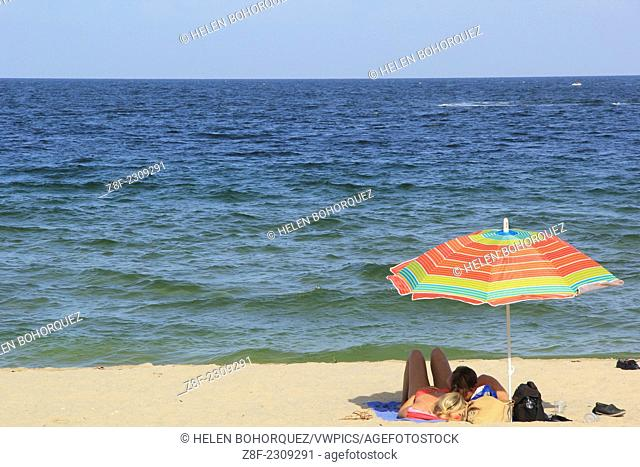 A couple shares a moment at Las Olas Beach at Fort Lauderdale, Florida, United States