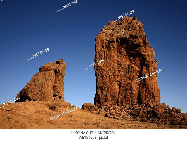 Hiker standing near Roque Nublo, Gran Canaria, Canary Islands, Spain
