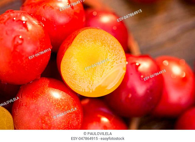 Fresh bright plums on wooden background