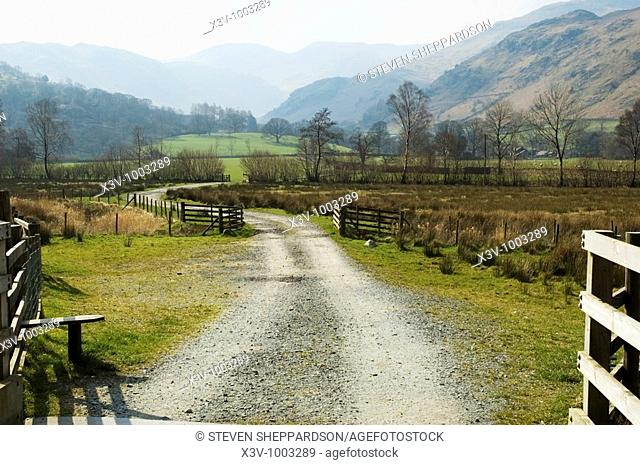Europe, UK, England, Cumbria - A farm track in the English Lake District with view to Fairfield in the background