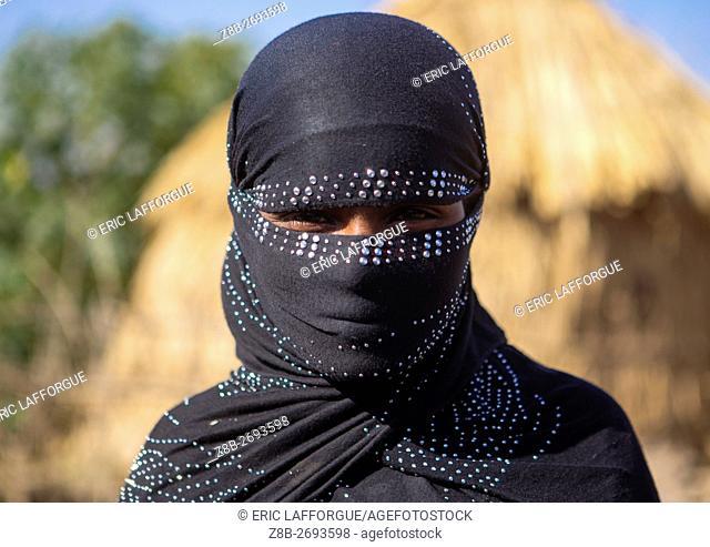 Ethiopia, Amhara Region, Artuma, portrait of an oromo woman with face covered
