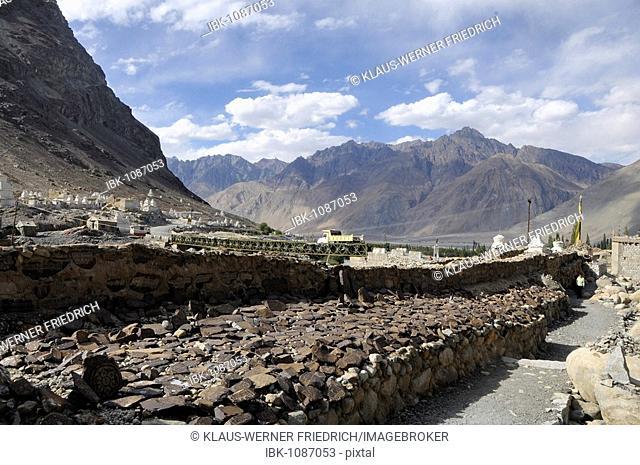 Mani (prayer inscribed) stones with Mantras on a Mani wall in the Hundar oasis, Nubra Valley, Ladakh, Jammu and Kashmir, North India, India, Asia