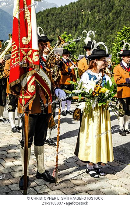 Local band members play in the village square on Patronage day in Reith bei Seefeld, Austria