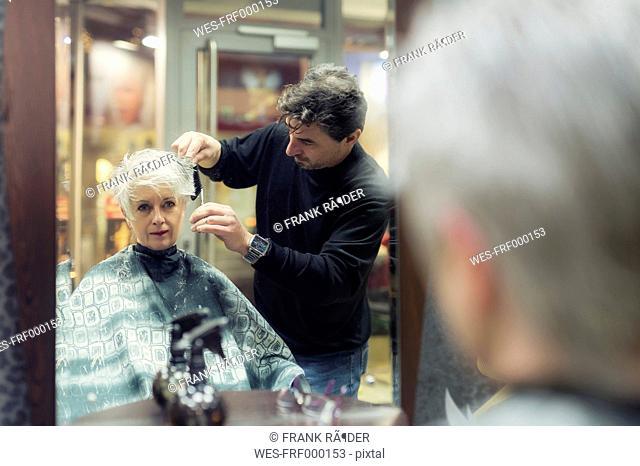 Senior woman getting new hair cut