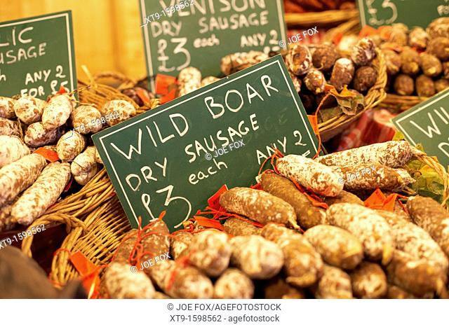 selection of dry cured meat sausages including wild boar on a stall in the continental market belfast northern ireland uk united kingdom