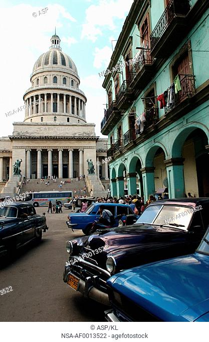 Front view of vintage cars parked outside a building, Havana, Cuba