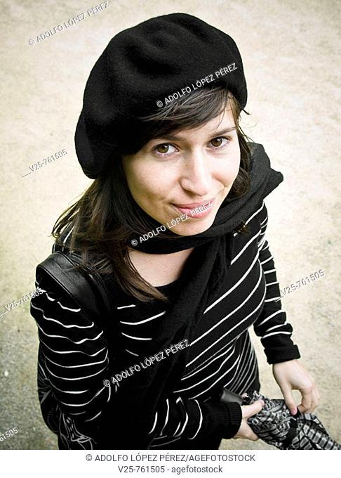 Young woman looking at camera. Paris, France