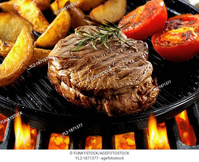 Beef fillet steaks & chips being pan fried on a bbq  Meat food photos, pictures & images