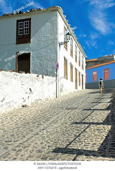 La Gomera, Canary Islands  Young woman on old cobbled street leading to the old town square in north coast town of Agulo