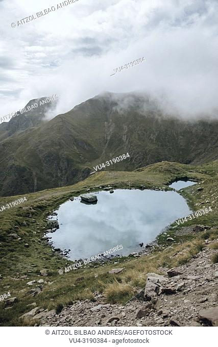A little lake going up to the border of spain and france, the picture was taken near the ski resort of Astun in spain