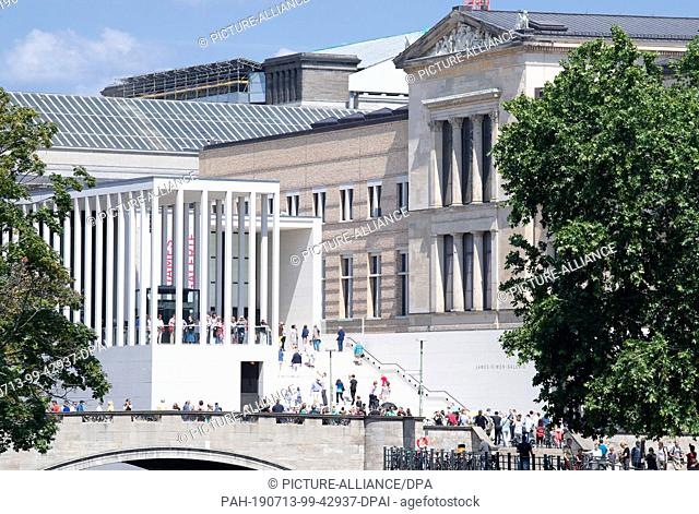 13 July 2019, Berlin: Visitors go up the stairs after the opening of the James Simon Gallery. The National Museums have invited to the opening of the gallery a...