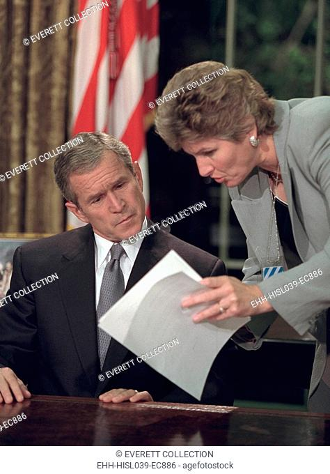 President George W. Bush reviews notes with Karen Hughes before speaking from the Oval Office. He spoke 12 hours after the 9-11 Terrorist attacks on New York...