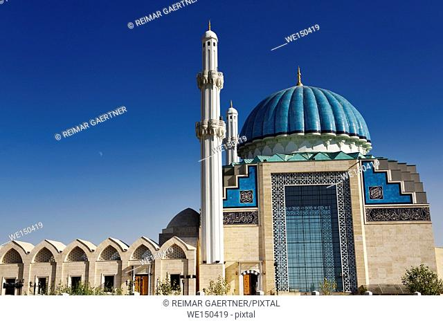 Blue ribbed dome and white minarets of Hoca Ahmet Yesevi Mosque in Turkistan Kazakhstan