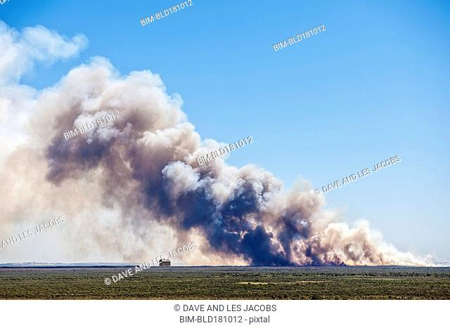 Smoke billowing from farmland fire