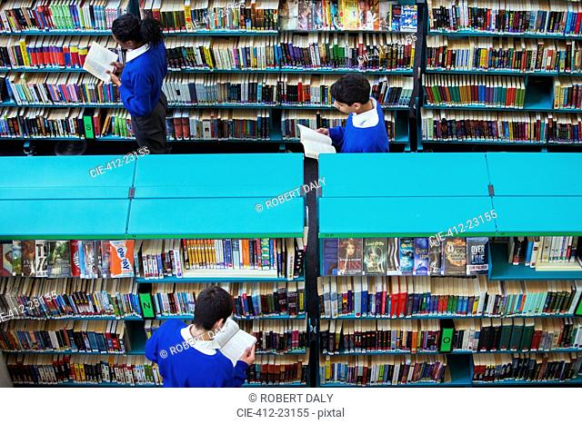 Elevated view of high school students browsing books in library