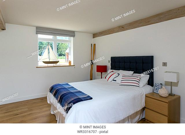 Bed and night table in modern bedroom