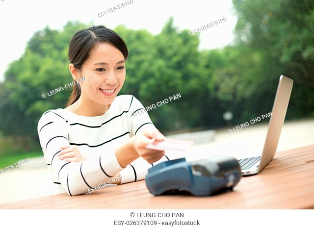 Woman pay by credit on the bill