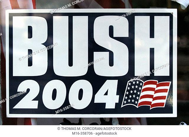 2004 presidential campaign: a Bush 2004 poster hangs in the window of a Washington DC business