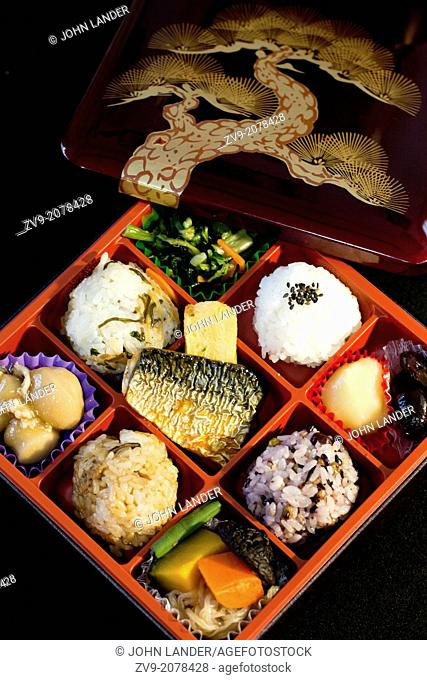 "The origin of bento can be traced back to the Kamakura Period when cooked and dried rice called hoshi-ii literally """"dried meal"""" was developed"