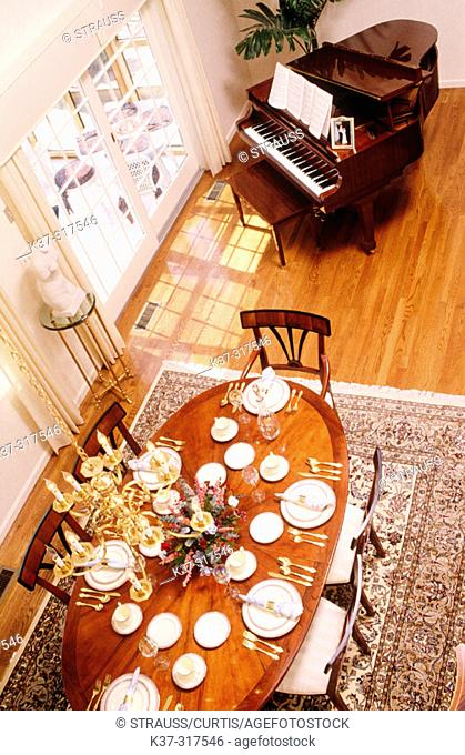 Dining room with table settings and piano