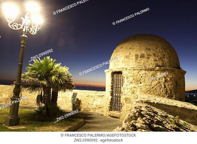 Scenic view of Bastioni Pigafetta against romantic autumnal twilight. Alghero, Sardinia. Italy