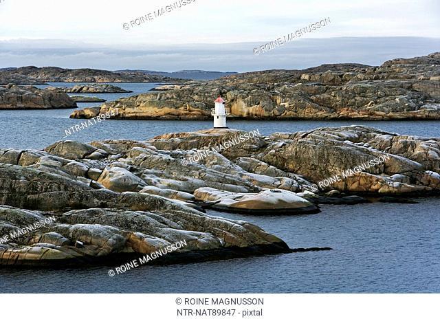Remote lighthouse on rocks