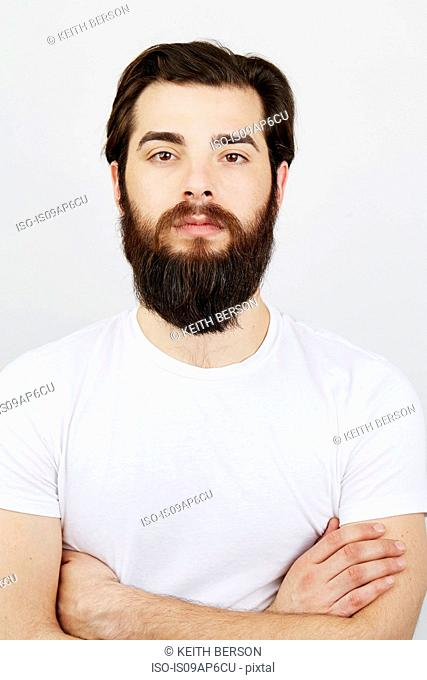 Portrait of bearded man in white t-shirt