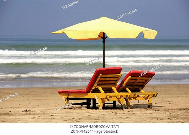 Inviting wooden chairs on a Bali beach
