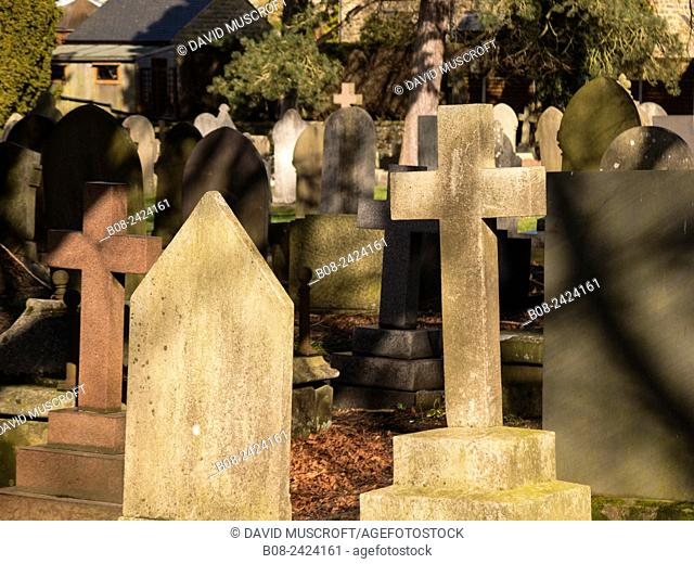 gravestones at All Saints Church, Ashover village, derbyshire,UK