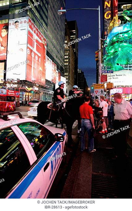 USA, United States of America, New York City: Times Square. Police patrol on horses