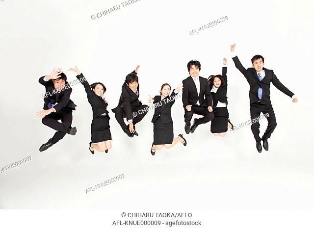 Japanese business people jumping
