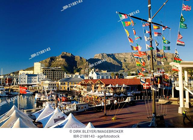 Colourful flags, boats, outdoor cafes, Table Mountain, Victoria & Alfred Waterfront, Cape Town, Western Cape, South Africa, Africa