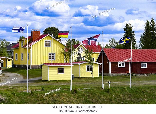 Finland, German, Swedish and Norwegian flags at a campground in Karesuando, Sweden's northernmost town on the border with Finland. Karesuando, Sweden