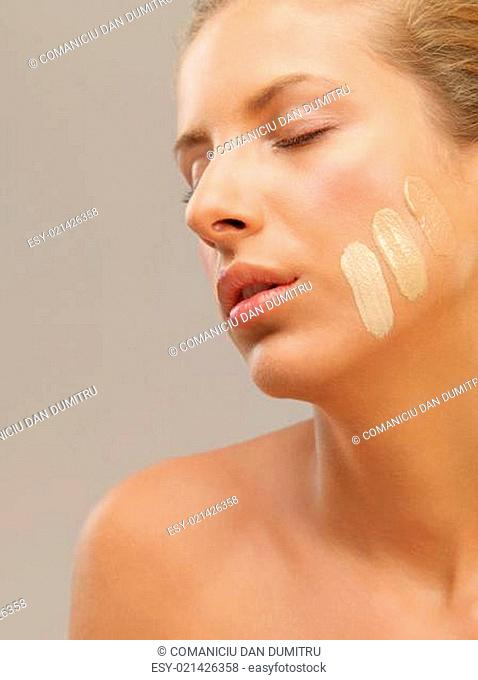 beautiful woman with three shades of foundation