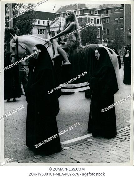Jan 1, 1960 - Flanked by two 'nuns' Lady Godiva(Mrs. Joyce Parker)Drives through the streets of Coventry during the carnival yesterday