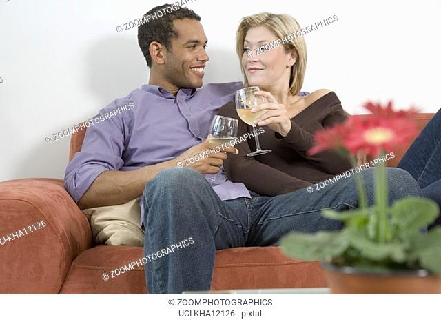 Couple drinking wine and laughing