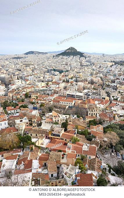 Higly populated districts of Plaka, Dexameni and Exarchia seen from The Acropils. In foreground Lycabetus Hill. Athens. Greece