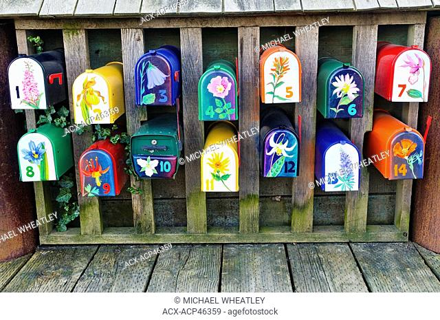Colourful wildflower painted mailboxes for houseboats at Sea Village on Granville Island, Vancouver, British Columbia, Canada