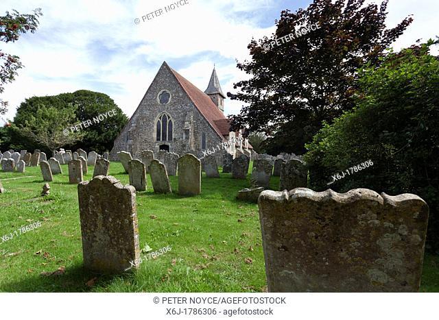 The 12C Church St Thomas à Becket, Warblington and gravestones in the churchyard