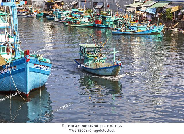 Traditional styled Vietnamese fishing boat coming into harbour at Dinh Cau, Pho Quoc, Vietnam, Asia