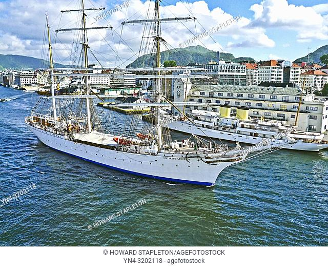 Statsraad Lehmkuhl. A three-masted barque rigged sail training vessel underway in harbor at Bergen, Norway