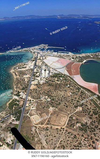 Es Savina harbor, Des Peix lagoon on the middle left and Pudent lagoon on the right, Ibiza in the distance, Formentera, Balearic Islands, Spain