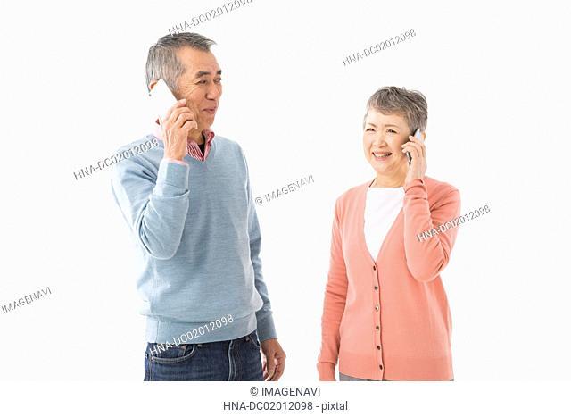 Senior couple talking on smart phone