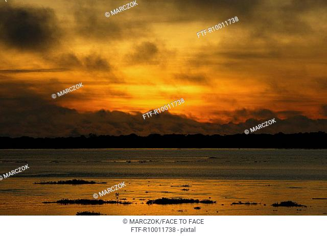 Sunset over a river, Solimes, Brazil, Manaus