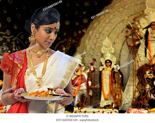 Bengali woman celebrating Durga puja