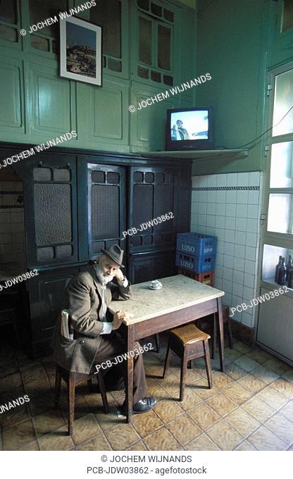 Lisbon, senior man in a bar in Chiado