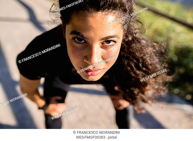Portrait of sportive young woman having a break